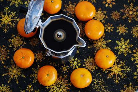 Italian espresso coffee maker moka pot in Christmas composition with tangerines