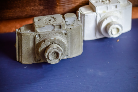 white and gray gypsum cameras
