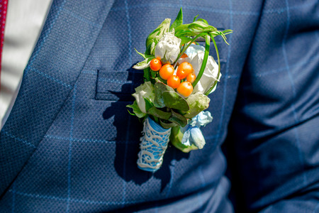 groom's boutonniere wedding in the spring