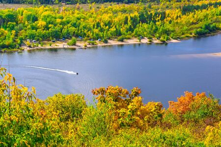 jet ski moves along the river or lake on a clear Sunny day in early autumn