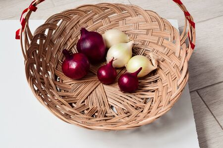 red onion and white onion wicker basket