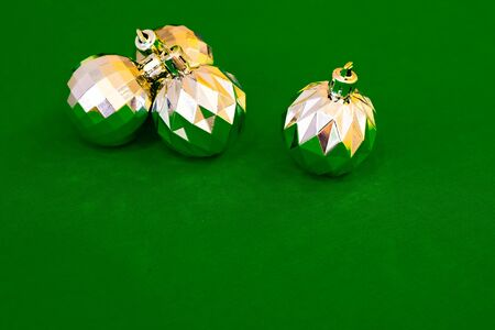 Christmas decoration silver or gold on green tablecloth or cloth Stock fotó