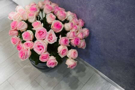 bouquet of pink roses on the floor of ceramic tiles