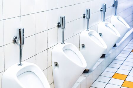 toilet with a number of urinals in a theater or restaurant