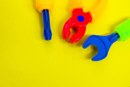 products made of colored plastic-toys and tools