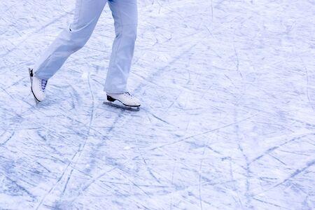skating people on a skating rink in a snow park Zdjęcie Seryjne