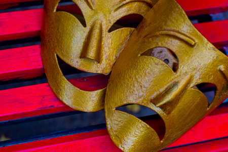 theatrical masks of tragedy and Comedy made of metal and painted