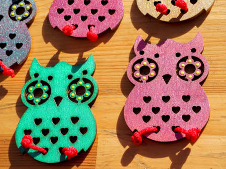crafts made of thin plywood in the shape of birds and insects, owls and butterflies