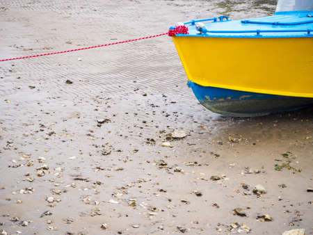 boat or motor boat and rigging in summer on a sandy beach on a Sunny day
