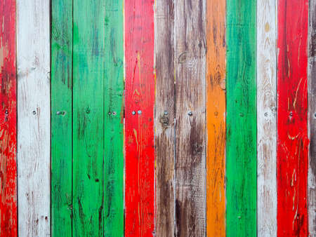 fence made of wooden boards painted with different colors of paint