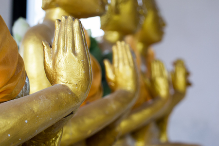 an obeisance: Hand Buddha Thailands what people respect Stock Photo