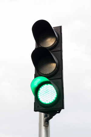 Green color on the traffic light. Stock Photo