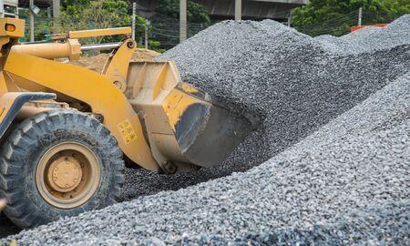 front end loader: Wheel loader Excavator unloading rock