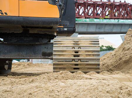 front end loader: Wheel loader Excavator with backhoe unloading sand at eath