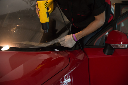 Technicians to repair the cars film.