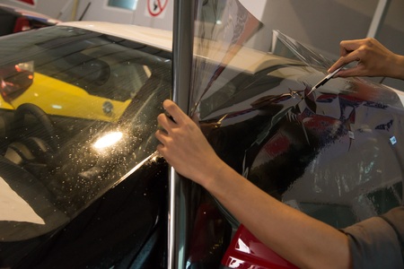 tinting: Technicians to repair the cars film.