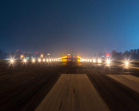airport sign: Landing lights at night closeup. Stock Photo