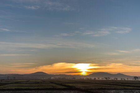 shined: Sunrise on them has light shined on the field Stock Photo