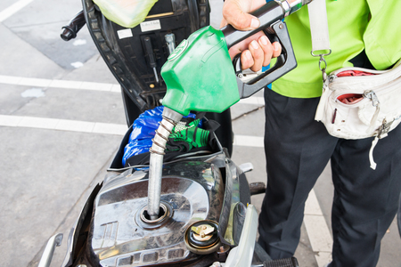 fueling pump: The staff give you bike. Stock Photo