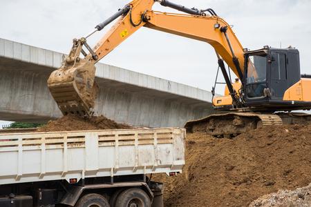 loader: Wheel loader Excavator unloading rock