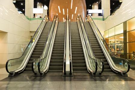 public building: Escalators move indoor public building. Stock Photo
