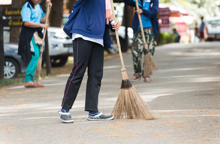 wicked woman: Street Sweeper Sweeping Pavement in Bangkok Stock Photo