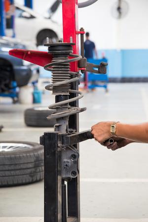shock absorber: Engineers are repairing shock absorber.