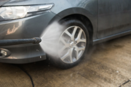 pressured: car washing cleaning with foam and hi pressured water. Stock Photo
