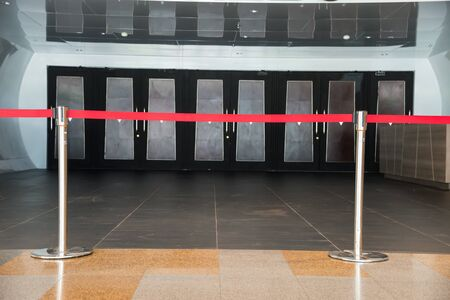 barrier rope: Rope barrier, and the door is closed