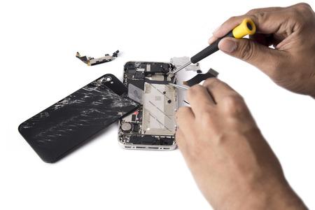 Hand Phone Repair in huis Stockfoto