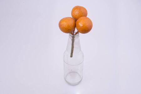 fake: Fake fruit on glass bottles.
