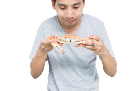 very happy man going to eat a big crab. Standard-Bild - 114184277