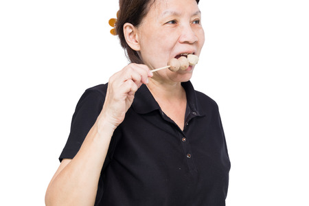 heavy risk: people eat grilled meat balls isolated on white backguounrd.