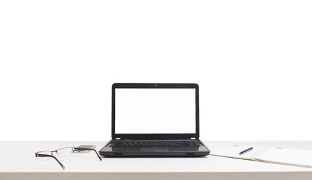 backgruond: office desk with laptop book and business office isolated on white backgruond. Stock Photo