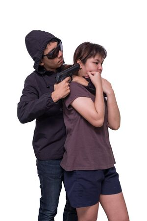 hostages: Bandits holding guns, captured the womens teen hostage. Stock Photo