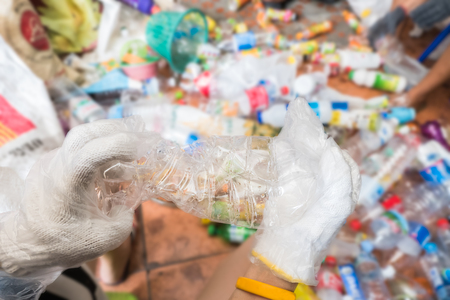 waste material: Recycling garbage and reusable waste management as old paper glass metal and plastic household products to be reused as a concept of environmental conservation of material saving energy and money.
