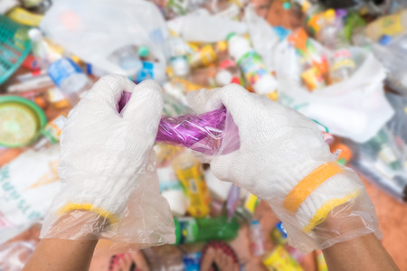 waste products: Recycling garbage and reusable waste management as old paper glass metal and plastic household products to be reused as a concept of environmental conservation of material saving energy and money.
