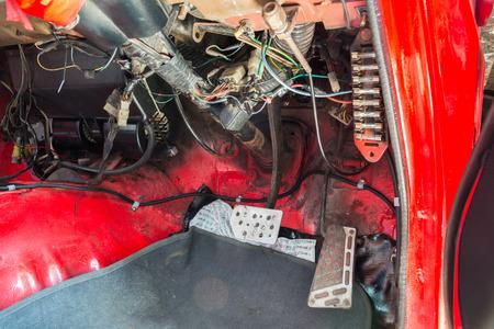 Repair of old car in the garage.