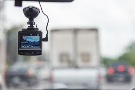 car video recorder installed on the window. Stock Photo