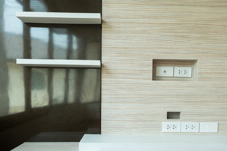 electric outlet: electric outlet in a wall in an modern house interior. Stock Photo
