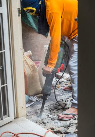 presslufthammer: floor repairing works with jackhammer