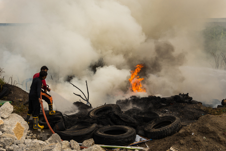 fireman: Nonthaburi, Thailand - March 11, 2017 : Firemen fighting the fire at wilderness area in Thailand