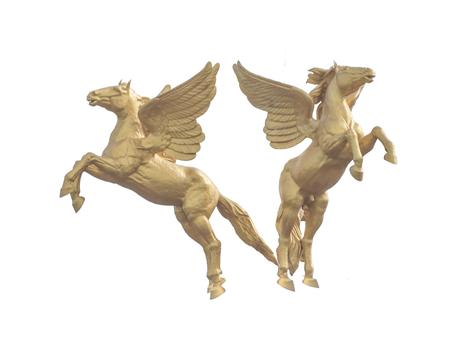 Gouden paardstandbeeld dat op witte achtergrond wordt geïsoleerd Stockfoto