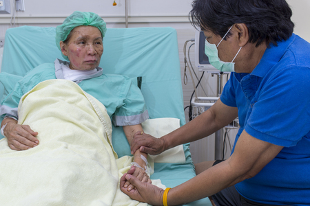 Nursing care and treatment for patient at burn unit in hospital.