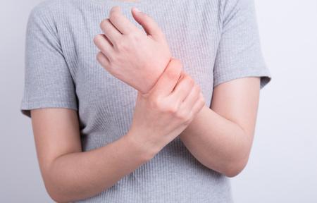 Asian woman wearing gray,Women wrist pain