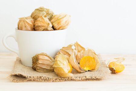 Cape gooseberry on a wooden table