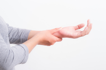 woman hands pain on white background,office syndrome concept