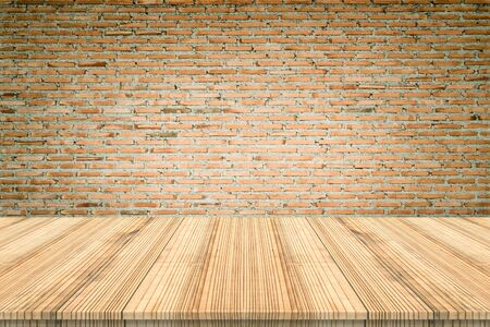 shiny floor: wood table top on brick wall background,Space available for the product