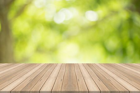 Empty wood table top on blurred abstract green background,Free space for editing products. Stock Photo - 84622578
