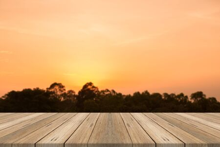 Wood table top on nature sunset blurred background,for montage your products